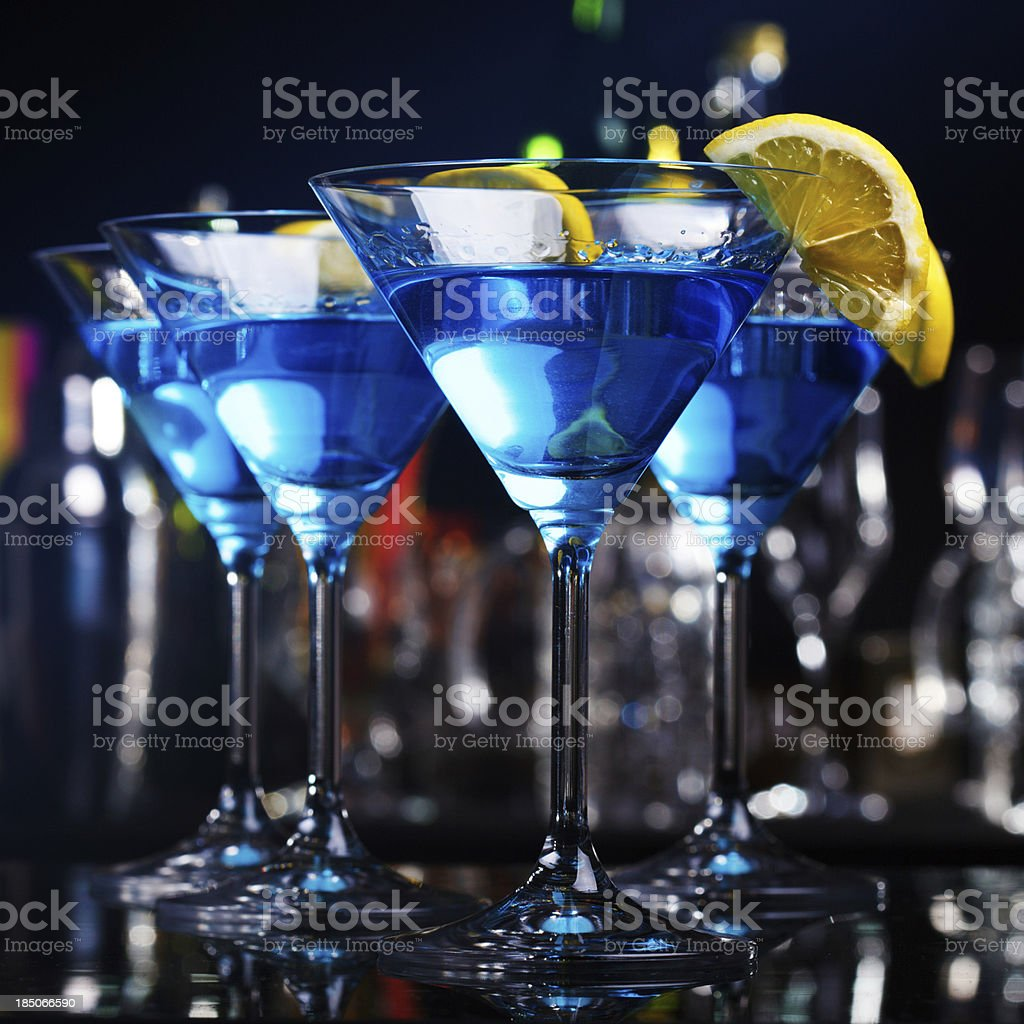 Blue curacao cocktails on a bar counter royalty-free stock photo