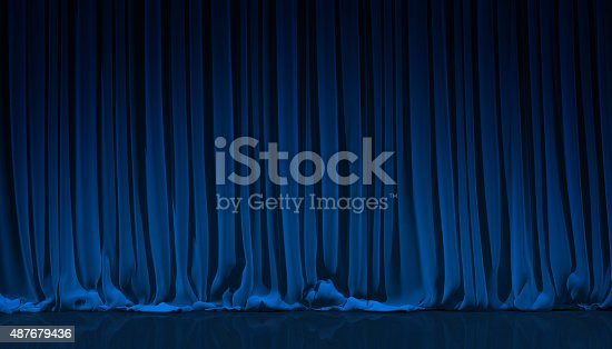 istock Blue curtain in theater. 487679436