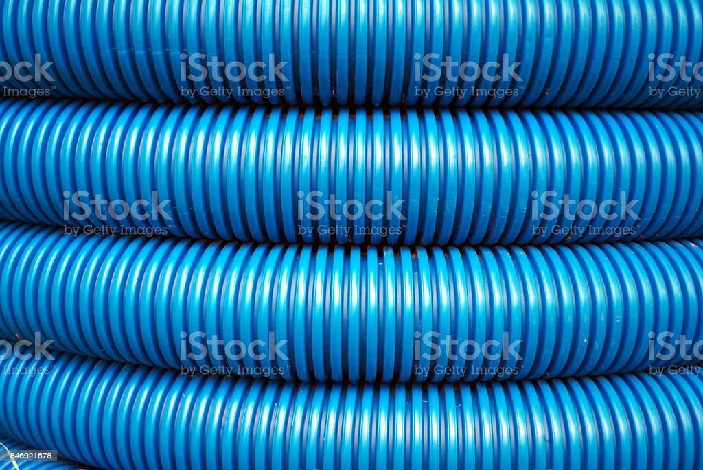 Blue curvilinear tubes for industry stock photo