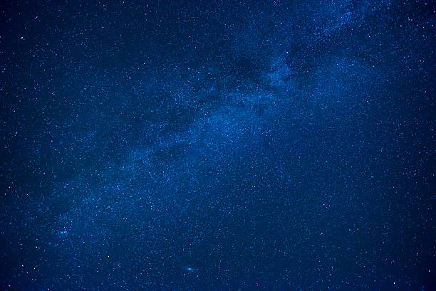 Blue dark night sky with many stars stock photo