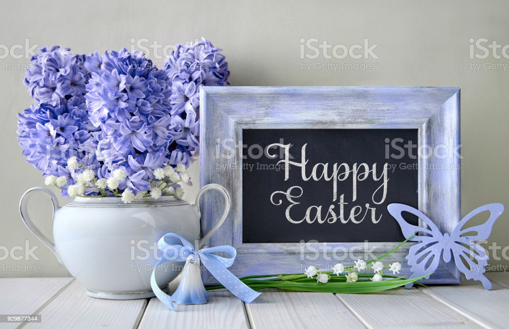 Blue decorations and hyacinth flowers on white table, blackboard blackboard with text stock photo