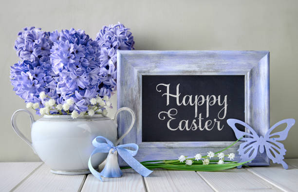 blue decorations and hyacinth flowers on white table, blackboard blackboard with text - welcome march stock photos and pictures