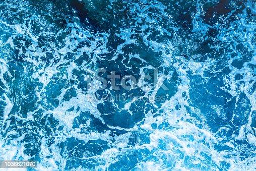 istock Blue deep sea foaming water background 1036621070