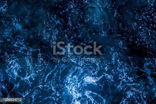 istock Blue deep sea foaming water background 1039534212