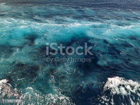istock Blue deep sea foaming water background 1175327402
