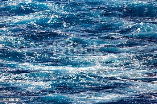 istock Blue deep sea foaming water background 912159192