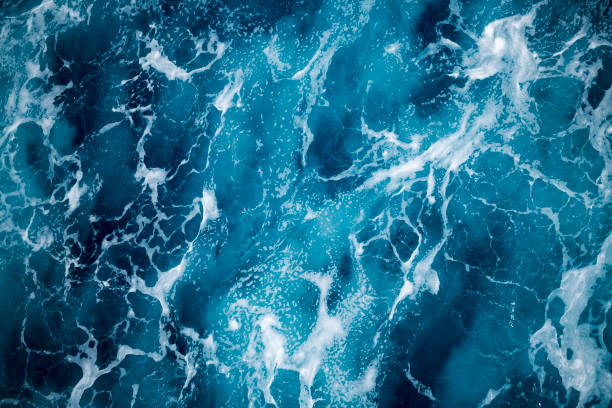 Blue deep sea foaming water background stock photo