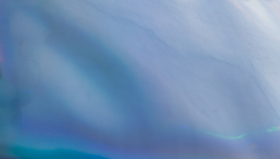 1010238190 istock photo Blue Defocused Blurred Motion Abstract Background 1198454499