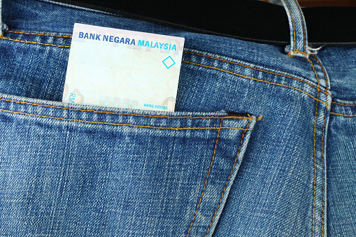 Blue Denim Jeans With Malaysian Banknote Inside Stock Photo - Download Image Now