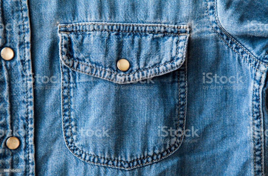 blue denim shirt pocket,fabric texture stock photo