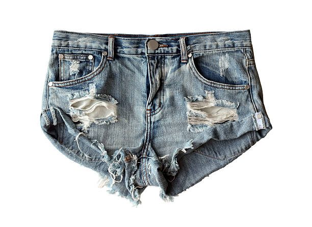 blue denim shorts ripped isolated on white background. flat lay - jean shorts stock photos and pictures