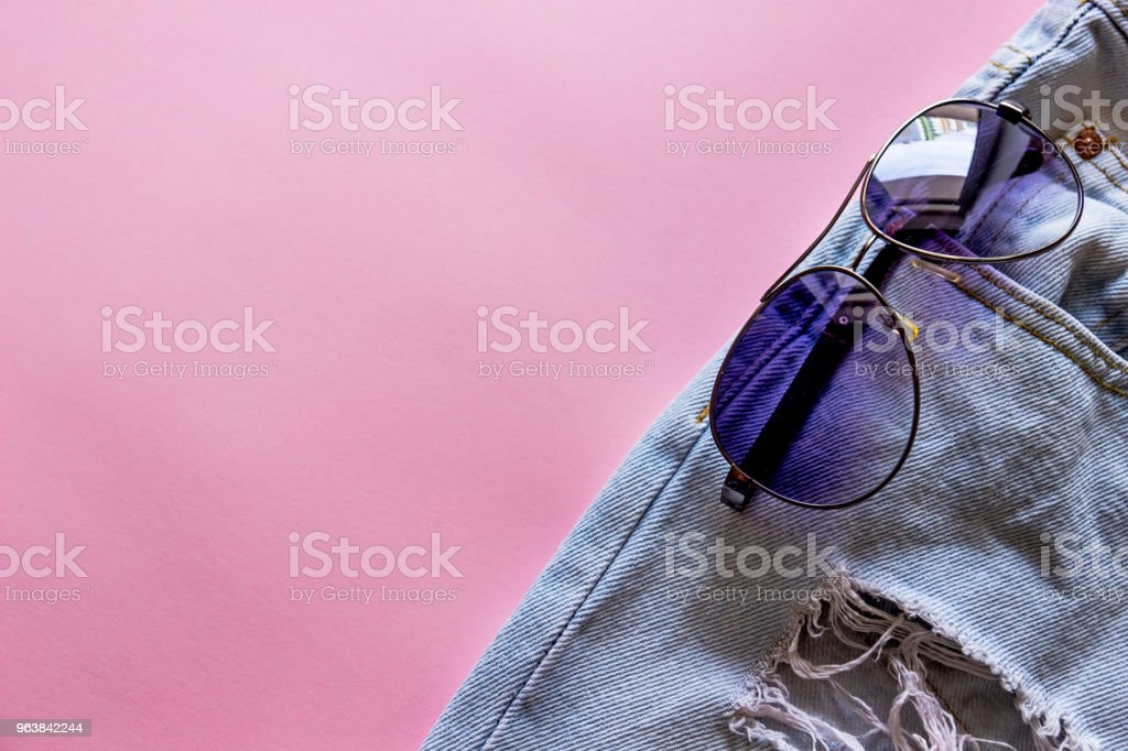blue denim shorts with andsunglasses in pockets, - Royalty-free Abstract Stock Photo