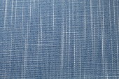 Background of a blue denim fabric texture. Ideal for an abstract background. Shows fine detail of the fabric material.