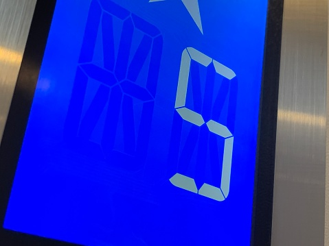 1023882582 istock photo Blue Device Screen in the elevator and number 5 - five 1184613943