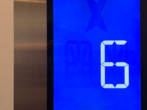 1023882582 istock photo Blue Device Screen in the elevator and number 6 - five - floor 1187148042