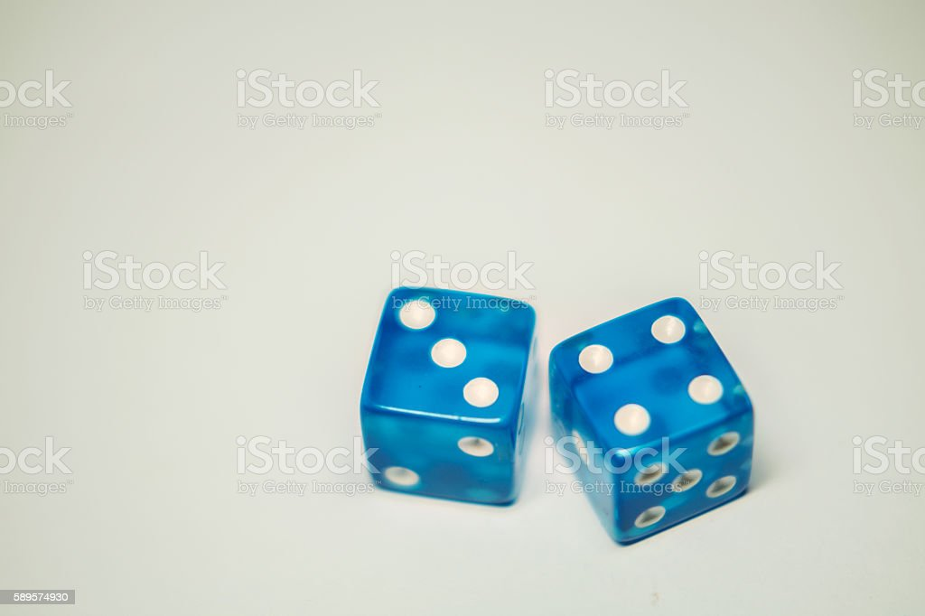 blue dice landed on seven stock photo