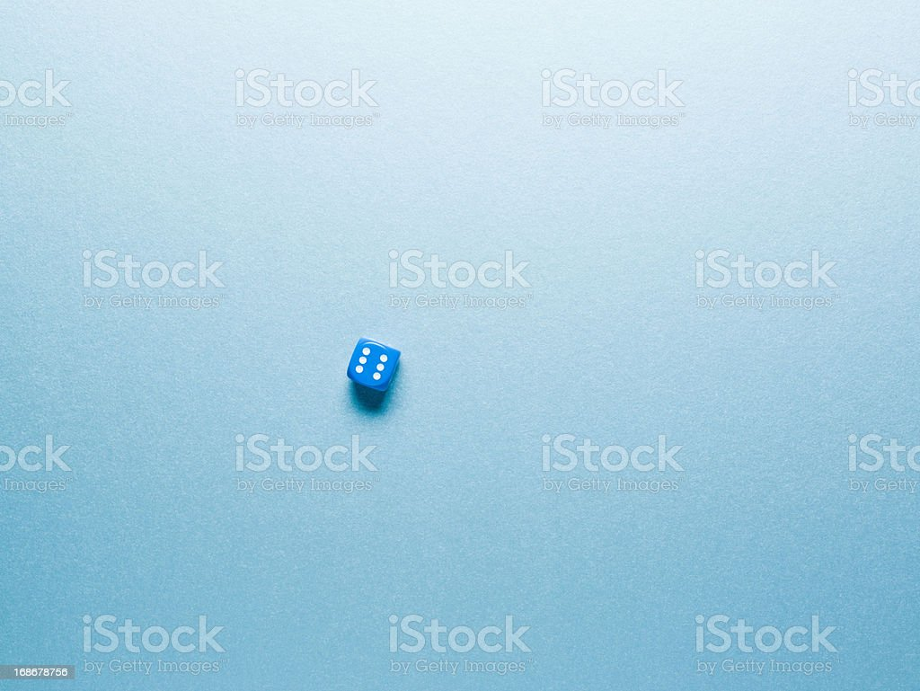 blue dice on surface stock photo