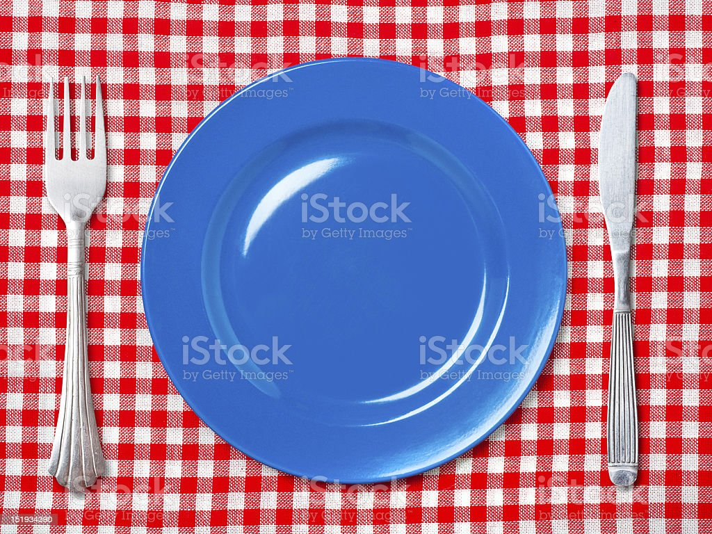 Blue dinner plate with fork and knife royalty-free stock photo