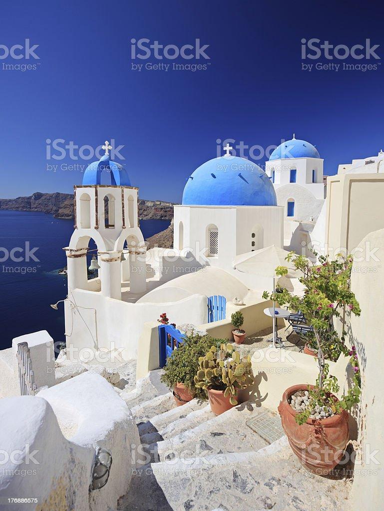 Blue dome church in Oia village on Santorini island, Greece stock photo