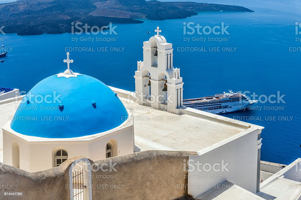 Blue dome church in town of Oia in Santorini, Greece stock photo