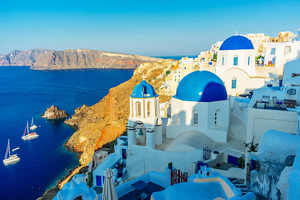 Blue dome churches in Oia stock photo