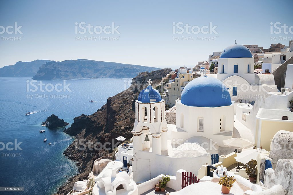 Blue domed church along caldera edge in Oia, Santorini stock photo