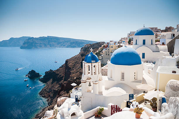 blue domed church along caldera edge in oia, santorini - caldera bildbanksfoton och bilder
