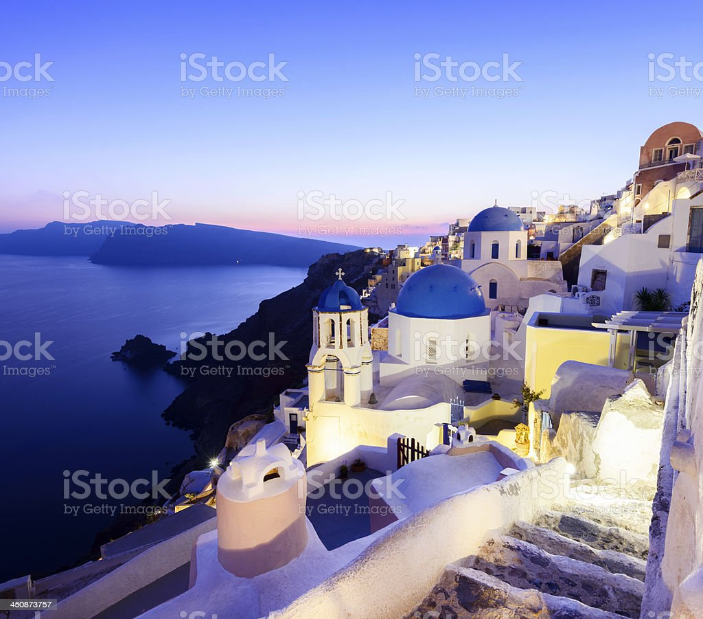 Blue Domed Church in Oia Village on Santorini Island Greece stock photo