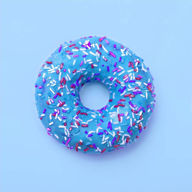 Blue donut in glaze on a blue background. Great fresh tasty cyan donut drizzled with glaze stock photo