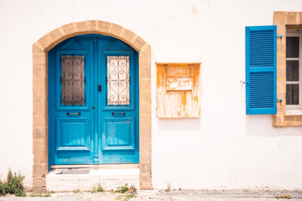 Blue door and colorful building in Paphos, Cyprus stock photo
