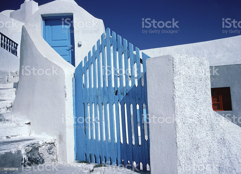 Blue Door and Gate, Red Window, Santorini, Greece royalty-free stock photo