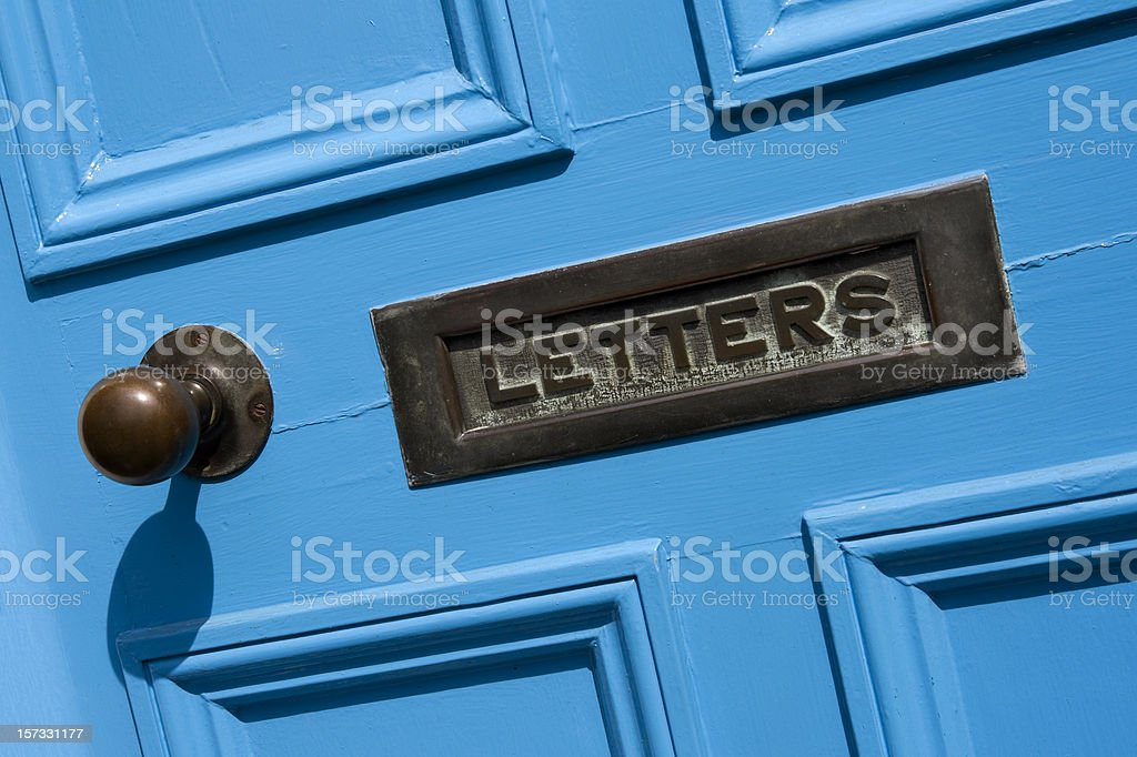 Blue door and letterbox royalty-free stock photo