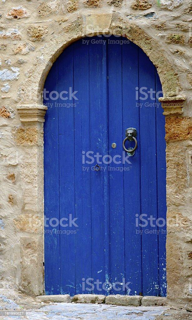 Blue door in a Greek town of Monemvasia stock photo
