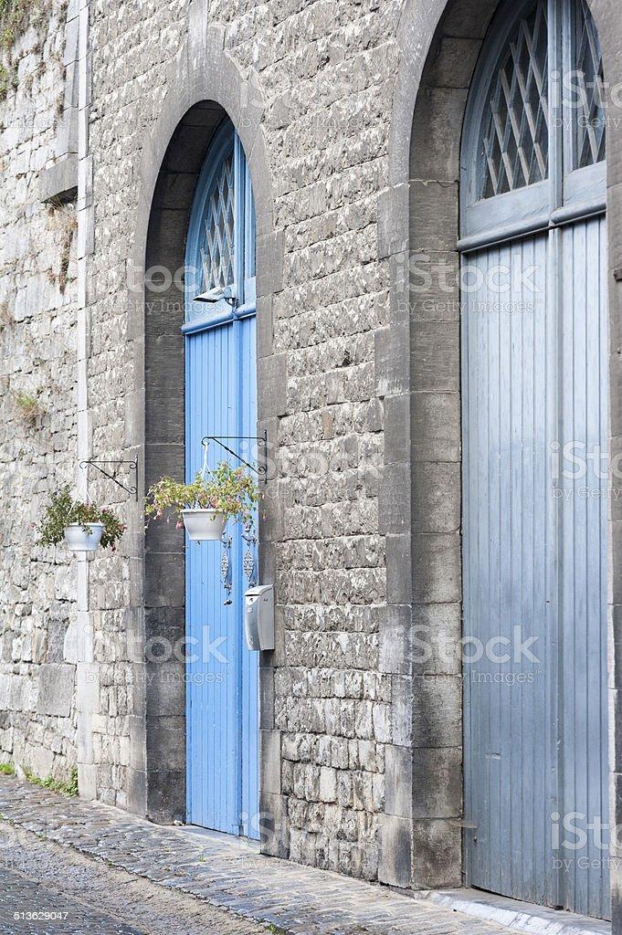 blue door in the city of Durbuy Belgium stock photo