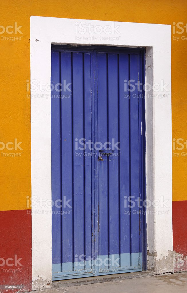 Blue door Vertical view of Blue door, El Tule, Oaxaca. Architecture Stock Photo
