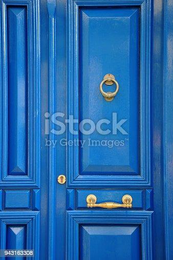 Blue door with golden details