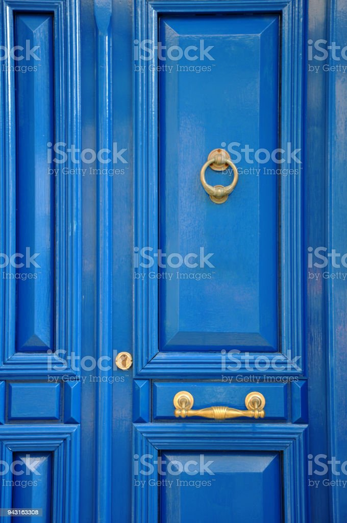 Blue door with golden details stock photo