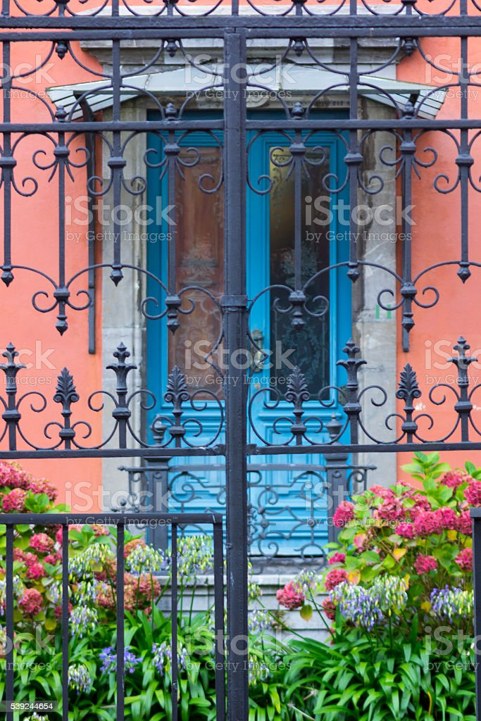 Blue door with windows and fence royalty-free stock photo
