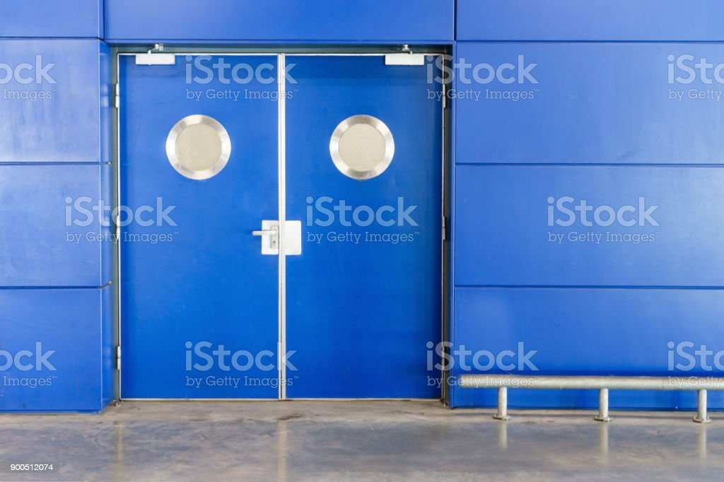 blue double door interior view of a room stock photo