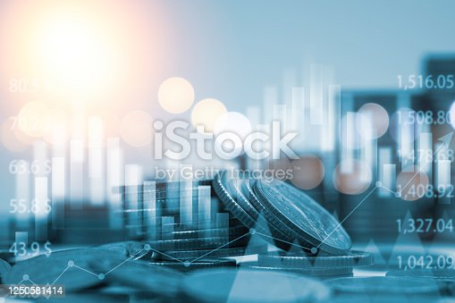 istock Blue double exposure of money coins stacking with bar graph for financial and investment business concept. 1250581414