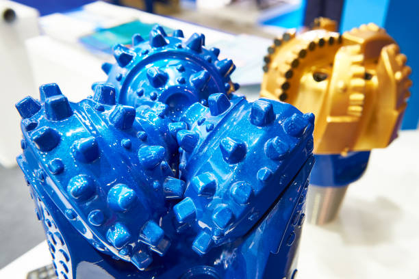 Blue drilling head for oil production Blue drilling head for oil production at the exhibition drill bit stock pictures, royalty-free photos & images
