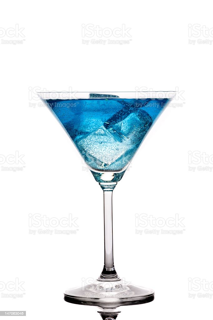 Blue drink being served by the glass on the table stock photo