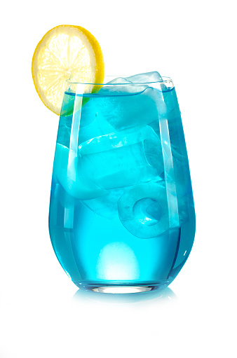 blue drink with ice cubes and lemon on white background, isolated
