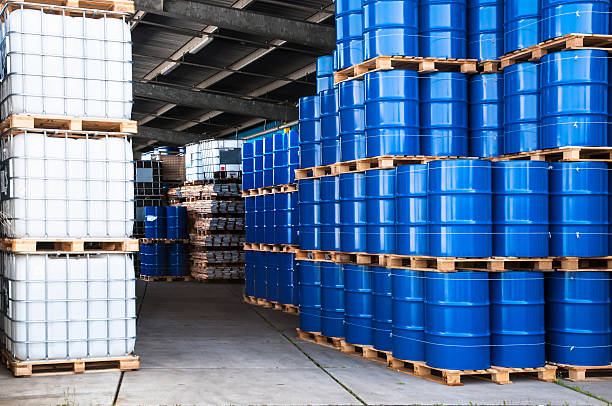 Blue drums and container Blue drums and IBC container in a storage room chemical plant stock pictures, royalty-free photos & images