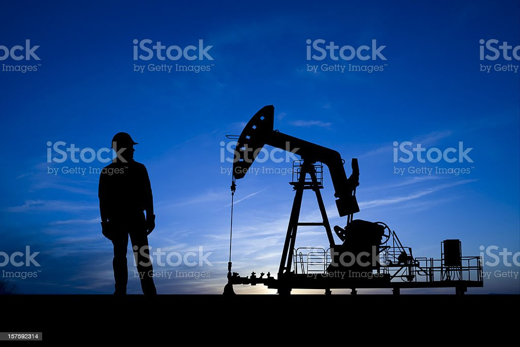 Blue Dusk Pumpjack and Oil Worker royalty-free stock photo