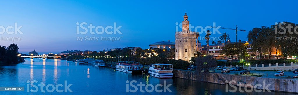 Blue dusk Seville Torre del Oro Guadalquiver royalty-free stock photo