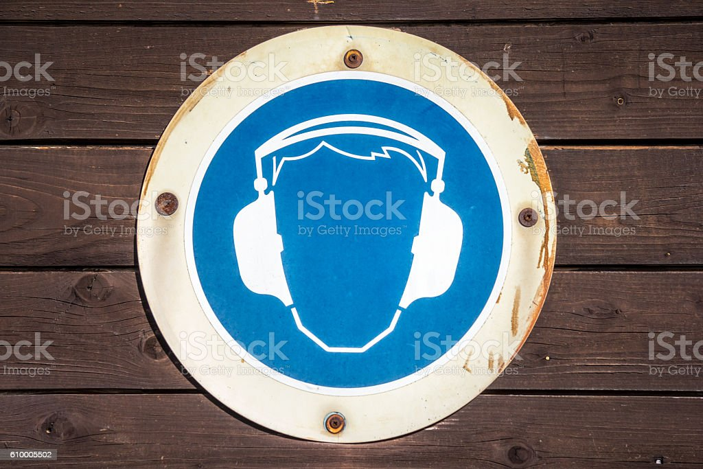 blue ear muff symbol on wood texture stock photo