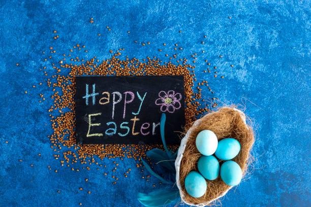 Blue easter eggs in nest next to blackboard with happy easter dark picture id1215093666?b=1&k=6&m=1215093666&s=612x612&w=0&h=bo9agttpc8rmor2wnlbshv36jouxgiwk6ipnee0i2we=