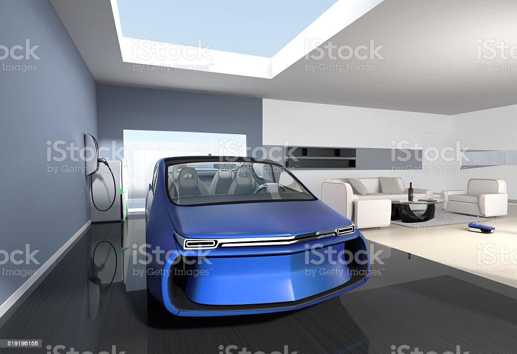 Blue electric car park into modern garage room stock photo