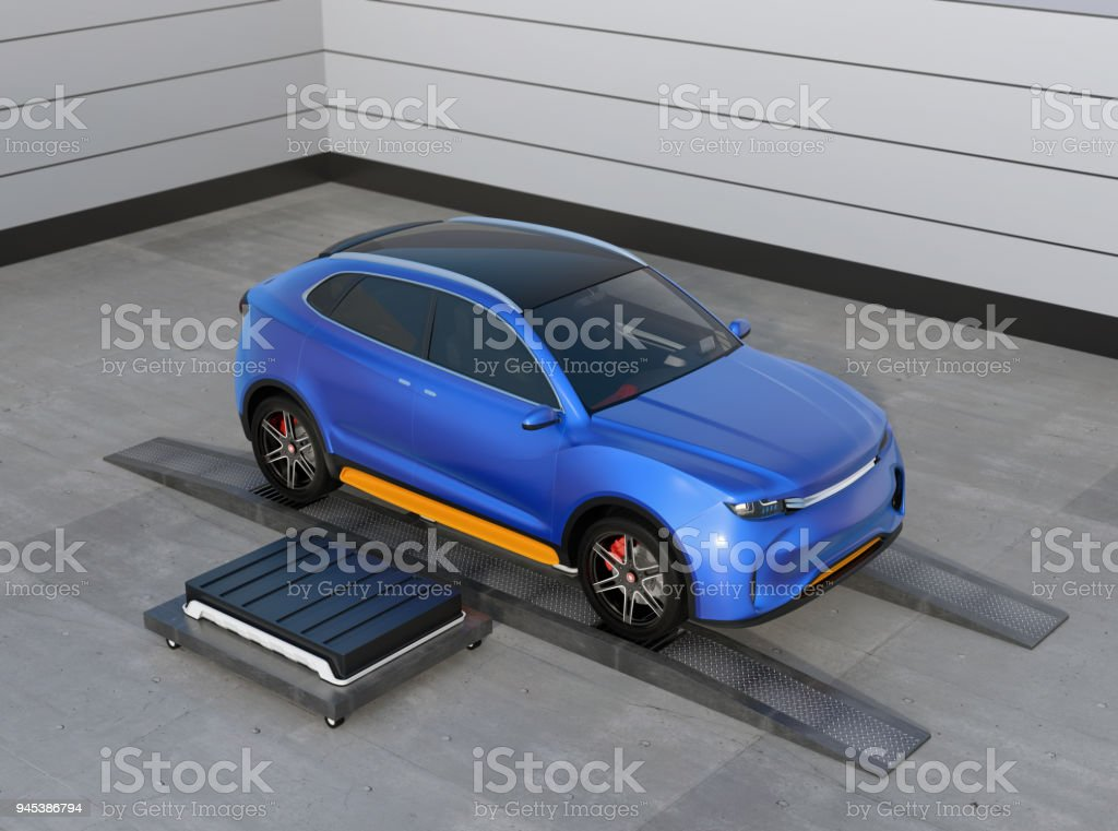 Blue electric SUV car in battery swapping station stock photo